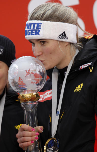 Natalie Geisenberger of Germany kisses the trophy during an awards ceremony after a women's race at the Sliding Center Sanki during the Luge World Cup 2013, in Krasnaya Polyana resort, some 60 kilometers (37 miles) east of Sochi, Russia, Saturday, Feb. 23, 2013. Natalie Geisenberger of Germany, already holding an unbeatable lead in the luge World Cup, heads the field in the series' last meet, a test event for the 2014 Sochi Olympics Sanki track. (AP Photo/Alexander Zemlianichenko)