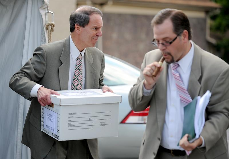Joe Amendola, left, attorney for Jerry Sandusky, loads boxes of files into his car after the trial, Thursday, June 14, 2012, in Bellefonte, Pa. The prosecution's case in Sandusky's sex abuse trial neared its conclusion on Thursday after just four days of testimony, with three more accusers taking the witness stand, including a young man who said the former Penn State assistant football coach raped him as a teen guest in Sandusky's home. (AP Photo/Centre Daily Times, Abby Drey) MANDATORY CREDIT, ALTOONA MIRROR OUT, LOCK HAVEN EXPRESS OUT, CLEARFIELD PROGRESS OUT, HARRISBURG PATRIOT-NEWS OUT, CENTRE COUNTY GAZETTE/STATECOLLEGE.COM OUT