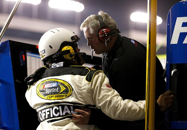 RICHMOND, VA - APRIL 28: Crew chief Bob Osborne (R) argues with an official after Carl Edwards (not pictured), driver of the #99 Eco-Boost Ford, was black flagged for an early restart during the NASCAR Sprint Cup Series Capital City 400 at Richmond International Raceway on April 28, 2012 in Richmond, Virginia. (Photo by Jeff Zelevansky/Getty Images for NASCAR)