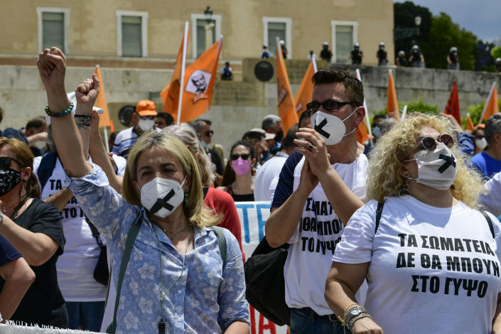 Protesters take part in a rally during a 24-hour labor strike, in Athens, Thursday, June 10, 2021. Widespread strikes in Greece brought public transport and other services to a halt Thursday, as the country's largest labor unions protested against employment reforms they argue will make flexible workplace changes introduced during the pandemic more permanent. (AP Photo/Michael Varaklas)