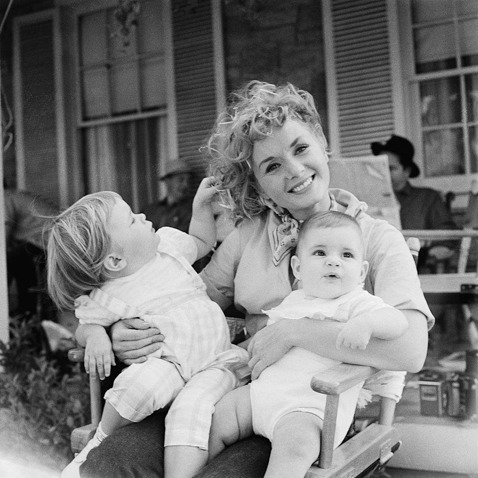 "<p>Carrie had a very close relationship with her mother. ""My three husbands all left me for another woman and obviously I wasn't a very sexual lady,"" Debbie told <em><a href=""https://www.express.co.uk/life-style/life/550164/Debbie-Reynolds-interview-husbands-interview"" rel=""nofollow noopener"" target=""_blank"" data-ylk=""slk:The Express"" class=""link rapid-noclick-resp"">The Express</a> </em>in 2015. ""It seemed that I was more interested in raising my children, not in pursuing my husbands."" Here, a three-year-old Carrie is seen on the set of MGM's <em>The Mating Game</em>. </p>"