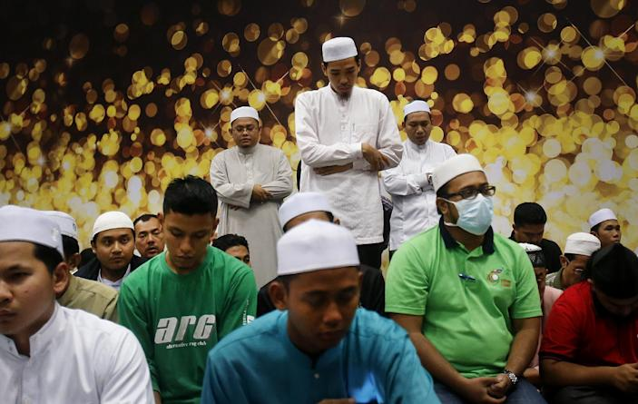 Muslim men offer prayers at the Kuala Lumpur International Airport for the missing Malaysia Airlines jetliner MH370, Thursday, March 13, 2014 in Sepang, Malaysia. Planes sent Thursday to check the spot where Chinese satellite images showed possible debris from the missing Malaysian jetliner found nothing, Malaysia's civil aviation chief said, deflating the latest lead in the six-day hunt. The hunt for the missing Malaysia Airlines flight 370 has been punctuated by false leads since it disappeared with 239 people aboard about an hour after leaving Kuala Lumpur for Beijing early Saturday. (AP Photo/Wong Maye-E)