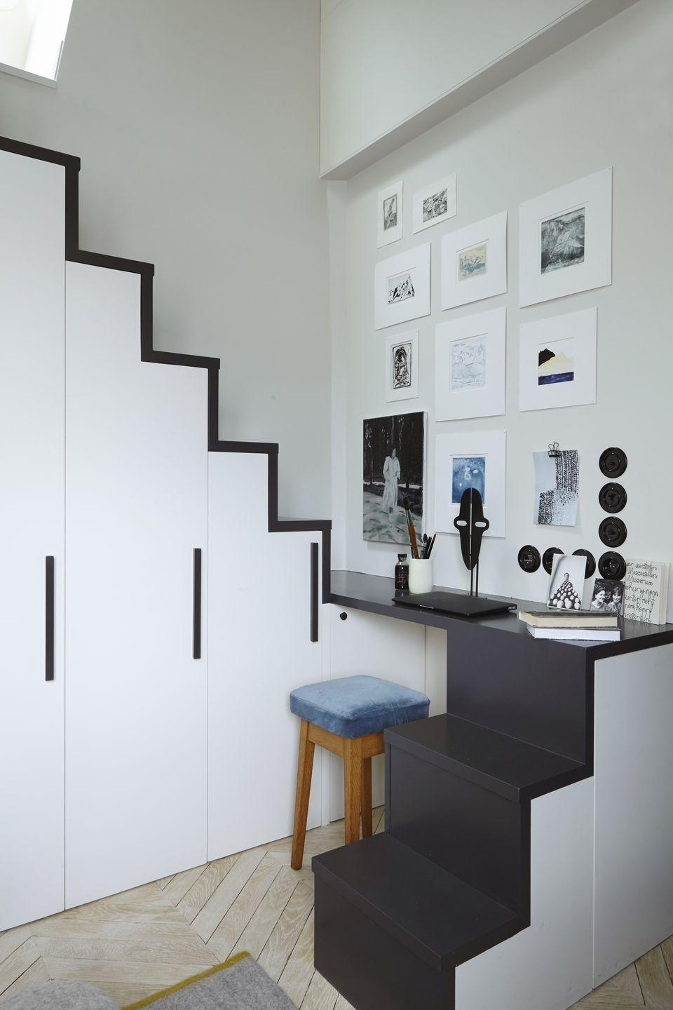 """<p>When space is at a premium, you sometimes have to think outside of the box. By raising the sleeping nook in this room onto a mezzanine and wrapping the staircase around, Paris-based interior designer Marianne Evennou has created a miniature desk space. Just be sure to tidy everything away before climbing up to bed. <a href=""""http://www.marianne-evennou.com/"""" rel=""""nofollow noopener"""" target=""""_blank"""" data-ylk=""""slk:marianne-evennou.com"""" class=""""link rapid-noclick-resp"""">marianne-evennou.com</a></p>"""