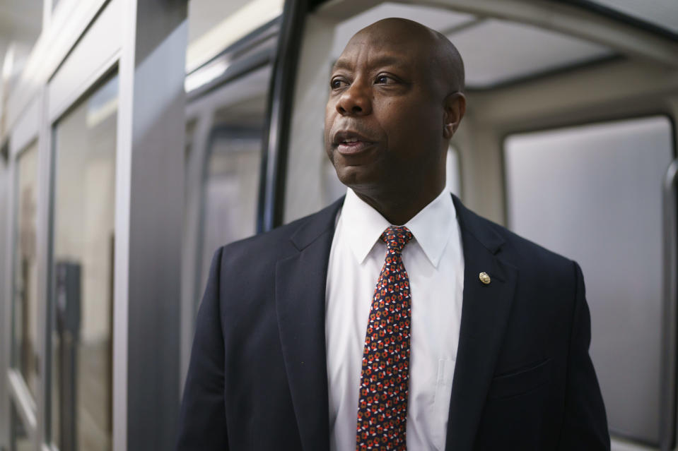 """FILE - In this May 27, 2021, file photo Sen. Tim Scott, R-S.C., arrives as senators go to the chamber for votes ahead of the approaching Memorial Day recess, at the Capitol in Washington. Congressional bargainers are likely to blow past their latest deadline without completing a bipartisan deal for overhauling police practices, three people familiar with the talks said Thursday, June 24, 13 months after George Floyd's killing and with the shadow of next year's elections lengthening over Congress' work. Despite a """"June or bust"""" goal set by chief GOP negotiator Scott, the Senate was expected to leave town for a two-week recess after Thursday's session without a final compromise, according to two Democratic aides who described the status of talks on condition of anonymity. (AP Photo/J. Scott Applewhite, File)"""