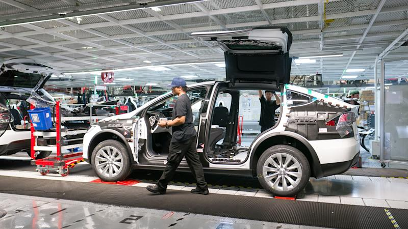 An employee working on a Model X at Tesla's factory in Fremont, California.