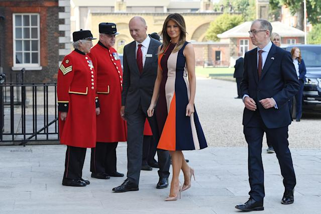 <p>Melania made a diplomatic choice for to visit the Royal Hospital Chelsea wearing a block-colour dress by British designer Victoria Beckham. <em>[Photo: Getty]</em> </p>