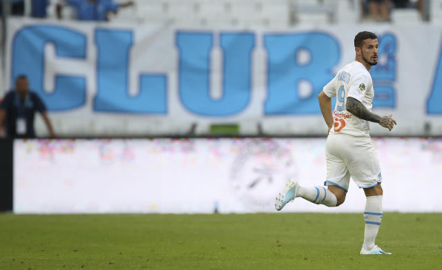 Marseille's Dario Benedetto runs onto the field from the subs bench during the French League One soccer match between Marseille and Reims at the Velodrome Stadium in Marseille, France, Saturday, Aug. 10, 2019. (AP Photo/Daniel Cole)
