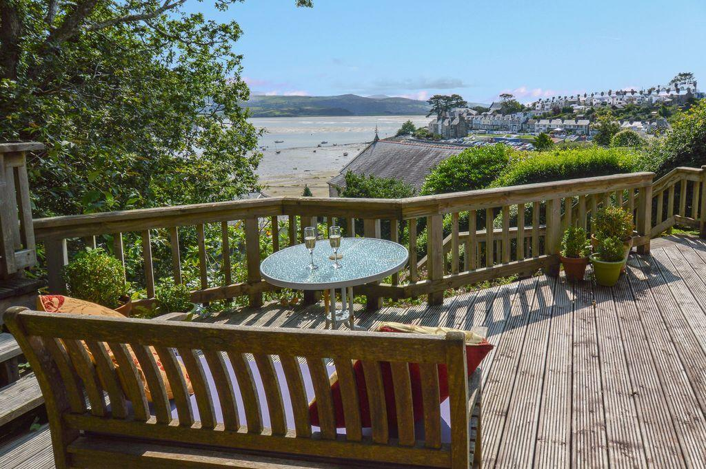 """<p>For something traditional, this superb beach cottage is nestled within ancient woodlands and offers excellent sea views in the pretty coastal village of Borth-y-Gest. You can enjoy the scene across Tremadog Bay from the terrace, while relaxing in the bedrooms and while feasting in the dining area. Inside, there's traditional and cosy decor, with a seaside theme in the bathroom, plus games and books to keep the children entertained.</p><p><strong>Sleeps:</strong> 4</p><p><strong>Price per night: </strong>£190</p><p><strong>Available from:</strong> <a href=""""https://go.redirectingat.com?id=127X1599956&url=https%3A%2F%2Fwww.homeaway.co.uk%2Fp8989692%3FadultsCount%3D4&sref=https%3A%2F%2Fwww.redonline.co.uk%2Ftravel%2Ftravel-guides%2Fg32739710%2Fbeach-cottages-uk%2F"""" target=""""_blank"""">HomeAway</a></p>"""