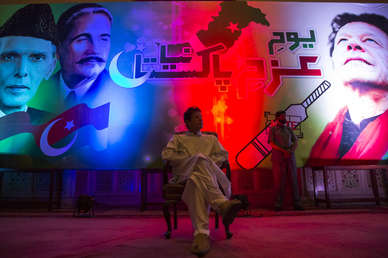 LAHORE, PAKISTAN - MAY 05: Imran Khan, chairman of the Pakistan Tehrik e Insaf (PTI) party, sits on stage prior to addressing volunteers and supporters during a rally for volunteers on May 05, 2013 in Lahore, Pakistan. Pakistan's parliamentary elections are due to be held on May 11. Imran Khan of Pakistan Tehrik e Insaf (PTI) and Nawaz Sharif of the Pakistan Muslim League-N (PMLN) have been campaigning hard in the last weeks before polling. (Photo by Daniel Berehulak/Getty Images)