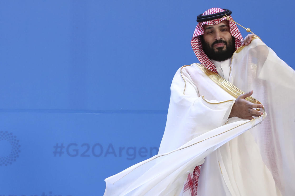 Saudi Arabia's Crown Prince Mohammed bin Salman adjusts his robe as leaders gather for the group at the G-20 Leader's Summit at the Costa Salguero Center in Buenos Aires, Argentina, Friday, Nov. 30, 2018. (Photo: Ricardo Mazalan/AP)