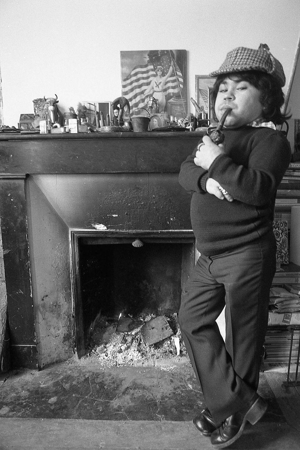 <p>Herve Villechaize, who played Tattoo in the TV series <em>Fantasy Island</em>, stands in Sherlock Holmes garb at his Paris apartment in 1973.</p>