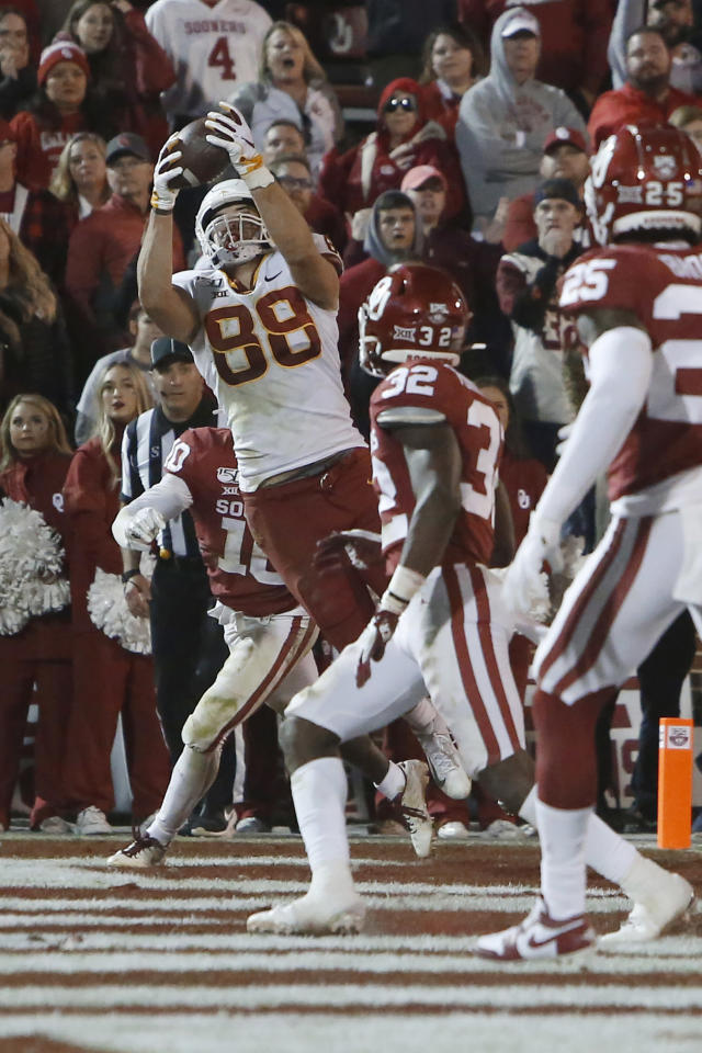 Iowa State tight end Charlie Kolar (88) catches a pass for a touchdown between Oklahoma safety Pat Fields (10) and safety Delarrin Turner-Yell (32) during the fourth quarter of an NCAA college football game in Norman, Okla., Saturday, Nov. 9, 2019. (AP Photo/Sue Ogrocki)