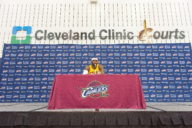 LeBron James of the Cleveland Cavaliers answers questions during media day at Cleveland Clinic Courts on September 26, 2014 in Independence, Ohio (AFP Photo/Jason Miller)