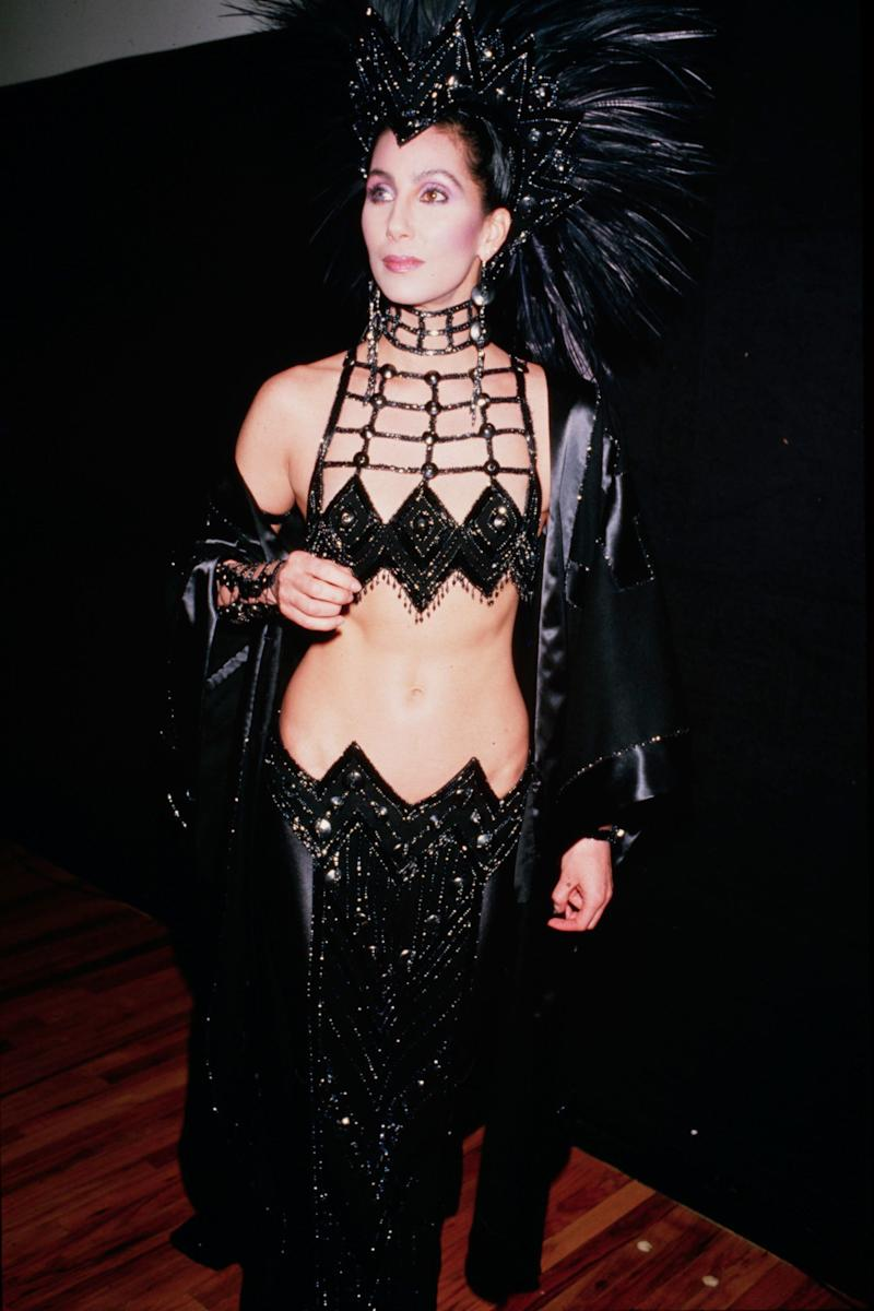 Cher's Bob sequin, velvet and head dress ensemble is the definition of old school extra. And we adore it.