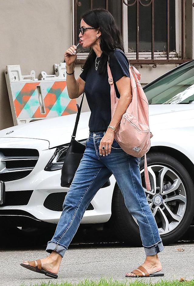 Courteney Cox was snapped enjoying a sweet while leaving Coco Arquette's play. (Photo: SPOT/BACKGRID)