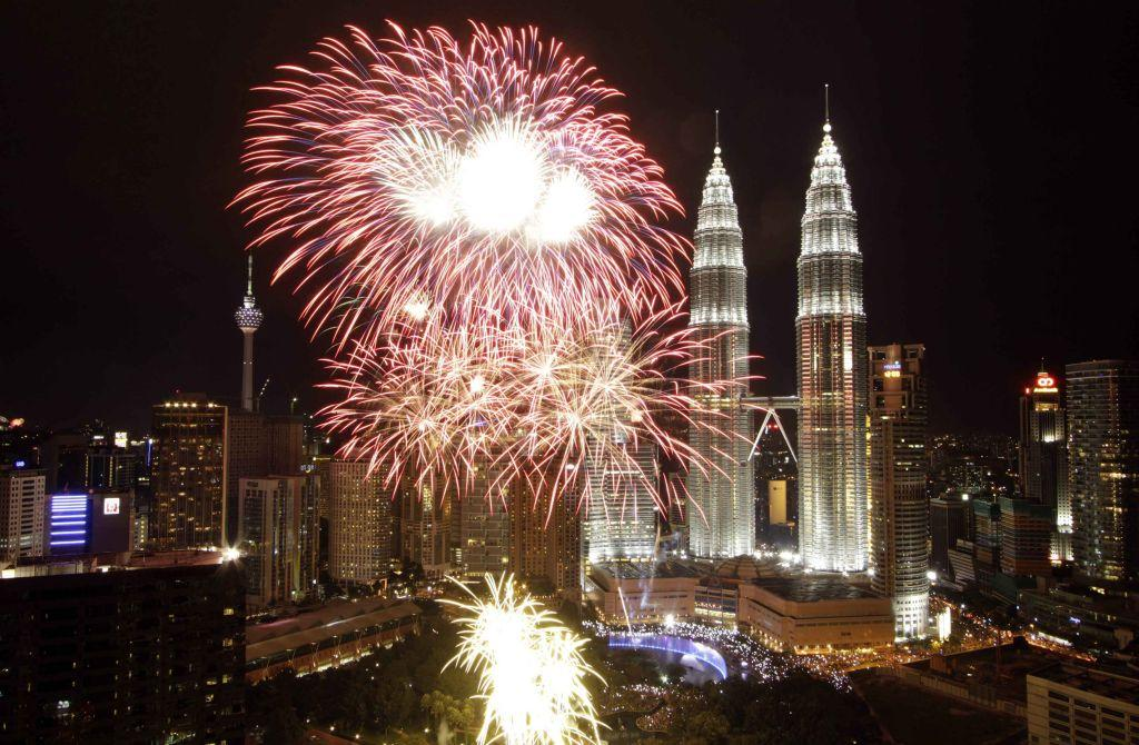 Fireworks explode near the Malaysia's landmark Petronas Twin Towers during New Year celebrations in Kuala Lumpur January 1, 2013.
