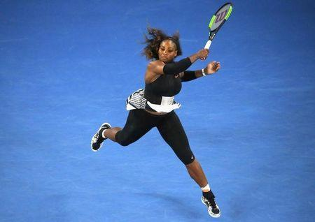 Serena Williams hits a shot during her women's singles second round match against Czech Republic's Lucie Safarova at the Australian Open. REUTERS/Jason Reed