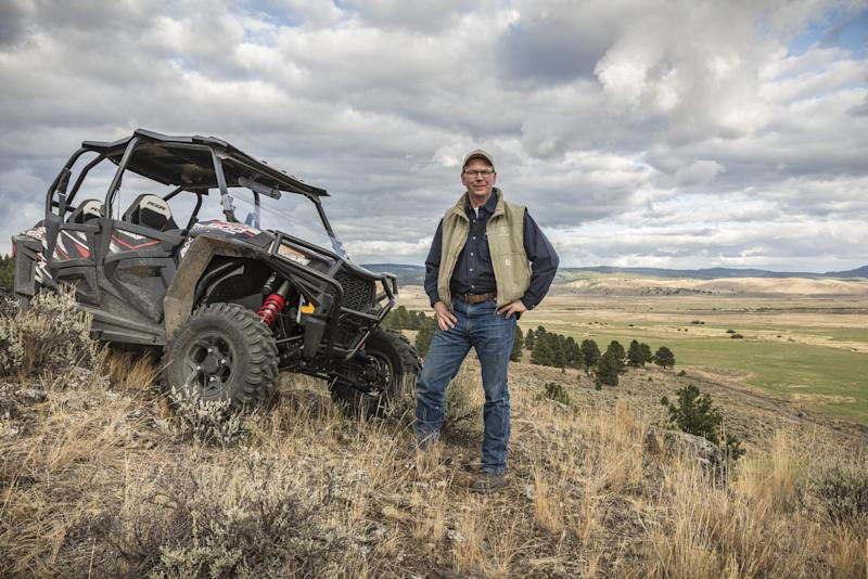 In this Sept. 21, 2017 photo provided by Silvies Valley Ranch, Colby Marshall, vice president of Silvies Valley Ranch poses for a picture in Burns, Ore: AP