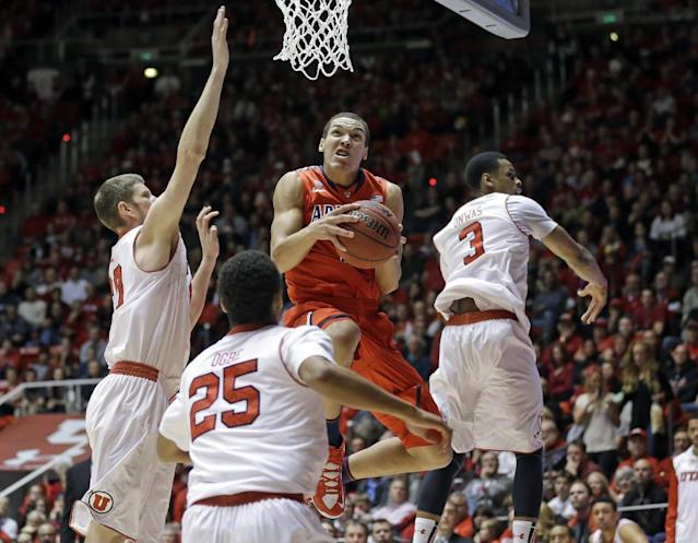 Arizona's Aaron Gordon, center, goes to the basket while Utah's Renan Lenz, left, Kenneth Ogbe (25) and Princeton Onwas (3) defend in the first half of an NCAA college basketball game, Wednesday, Feb. 19, 2014, in Salt Lake City. (AP Photo/Rick Bowmer)