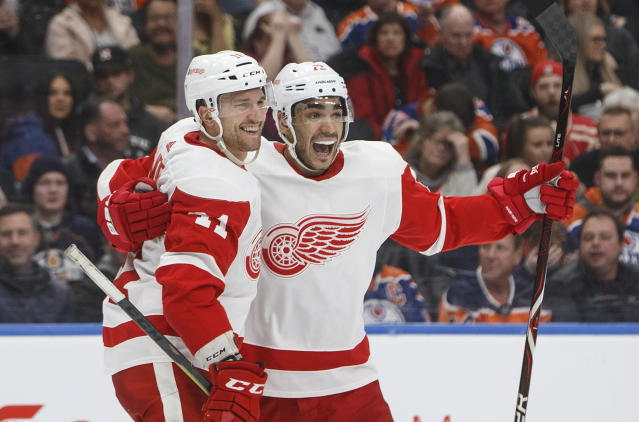 Detroit Red Wings' Luke Glendening (41) and Andreas Athanasiou (72) celebrate a goal during third period NHL action against the Edmonton Oilers, in Edmonton on Tuesday, Jan. 22, 2019. (Jason Franson/The Canadian Press via AP)