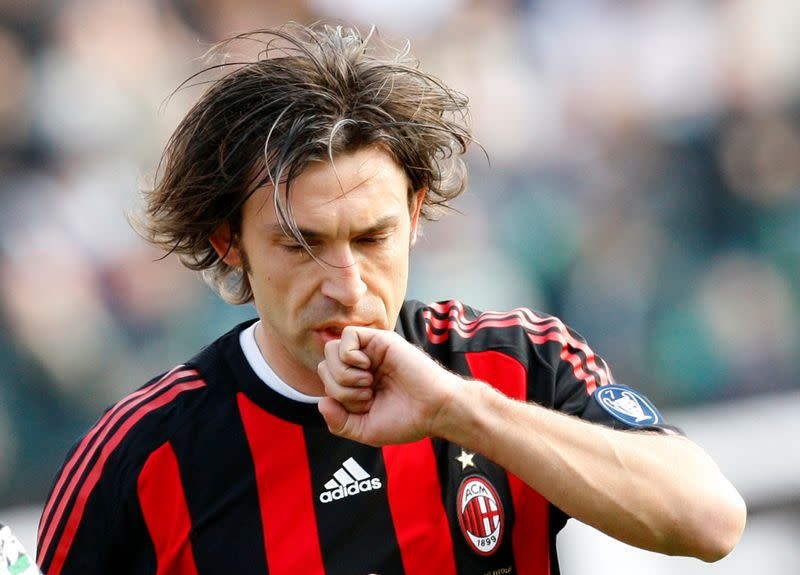 FILE PHOTO: AC Milan's Pirlo celebrates after scoring a penalty against Siena during their Italian Serie A soccer match in Siena