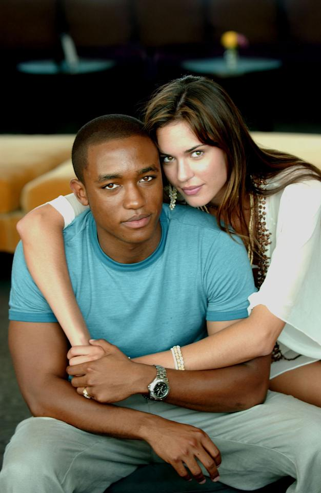 "Lee Thompson Young and Odette Yustman in ""South Beach."""