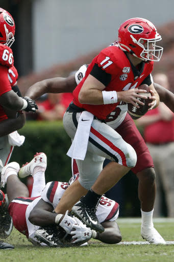Georgia quarterback Jake Fromm (11) is brought down by South Carolina defensive lineman Kobe Smith (95) in the second half of an NCAA college football game Saturday, Oct. 12, 2019, in Athens, Ga. (AP Photo/John Bazemore)