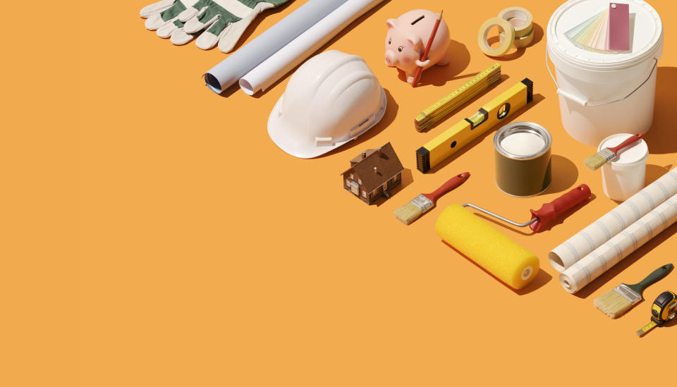 Home renovation, repair and construction: isometric model house and tools with copy space