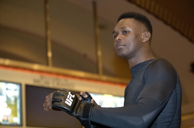 UFC middleweight champion Israel Adesanya, of Nigeria, prepares for a UFC 248 open workout in Las Vegas on Wednesday. (Steve Marcus/Las Vegas Sun via AP)
