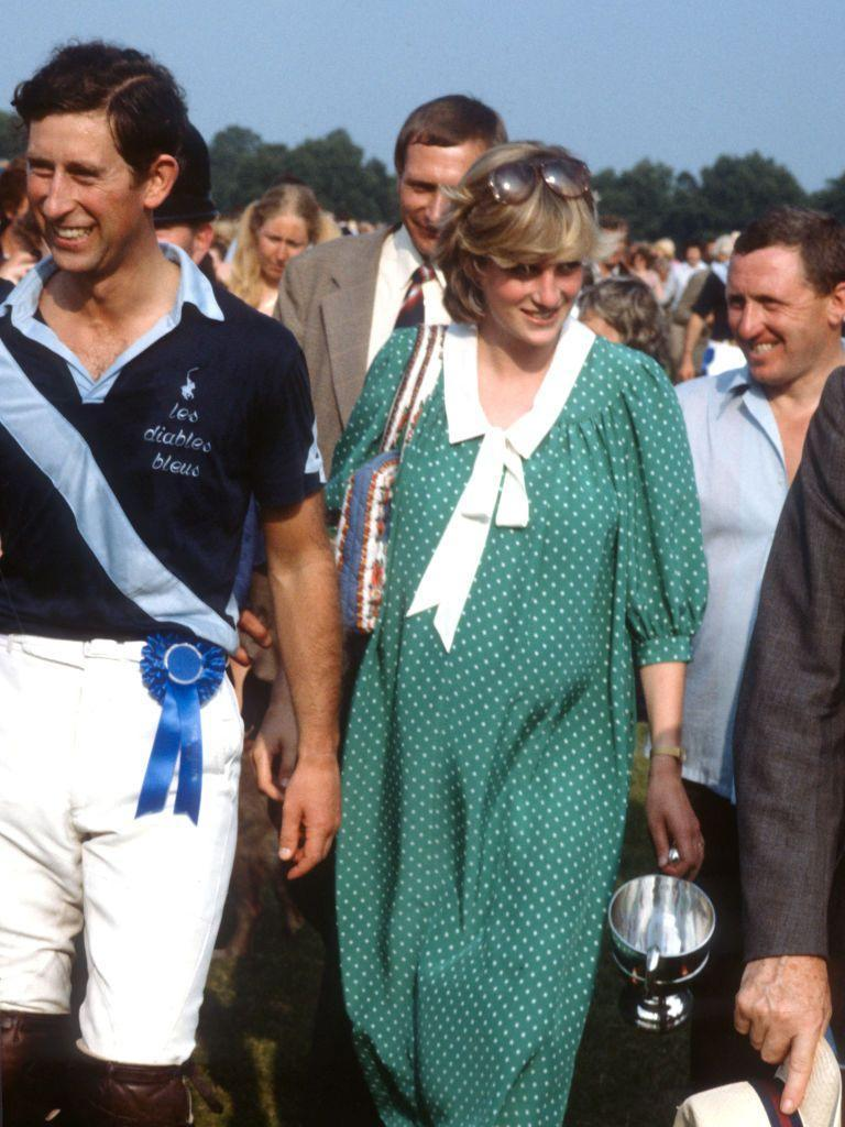 <p>Princess Diana wearing a green and white polka dot maternity dress designed by Catherine Walker with a white wide collar, while pregnant with Prince William in 1982.</p>