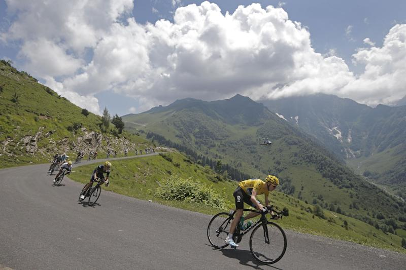 Christopher Froome of Britain, wearing the overall leader's yellow jersey, and Nairo Alexander Quintana of Colombia, wearing the best young rider's white jersey, in third position, speed down Val Louron-Azet pass during the ninth stage of the Tour de France cycling race over 168.5 kilometers (105.3 miles) with start in Saint-Girons and finish in Bagneres-de-Bigorre, Pyrenees region, France, Sunday July 7 2013. (AP Photo/Laurent Cipriani)