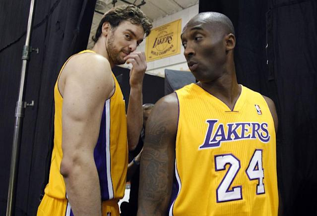 Los Angeles Lakers forward Pau Gasol, left, of Spain, stands with guard Kobe Bryant, right, during the NBA basketball team's media day Saturday, Sept. 28, 2013, in El Segundo, Calif. (AP Photo/Alex Gallardo)