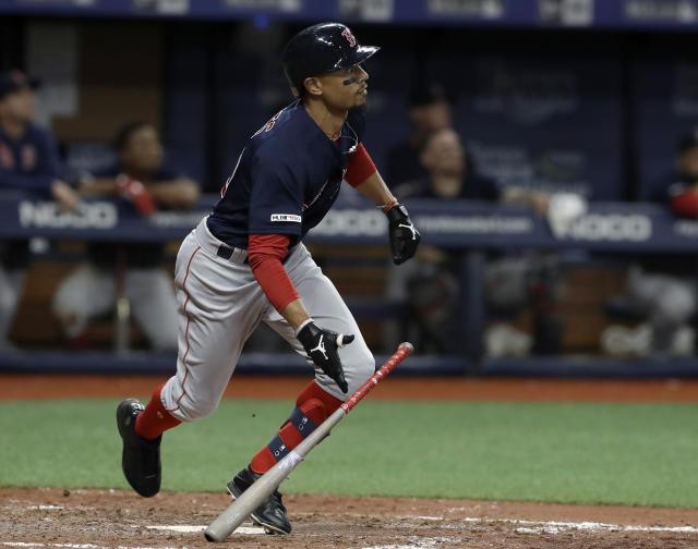 Boston Red Sox's Mookie Betts watches his home run off Tampa Bay Rays relief pitcher Diego Castillo during the eighth inning of a baseball game Friday, April 19, 2019, in St. Petersburg, Fla. (AP Photo/Chris O'Meara)