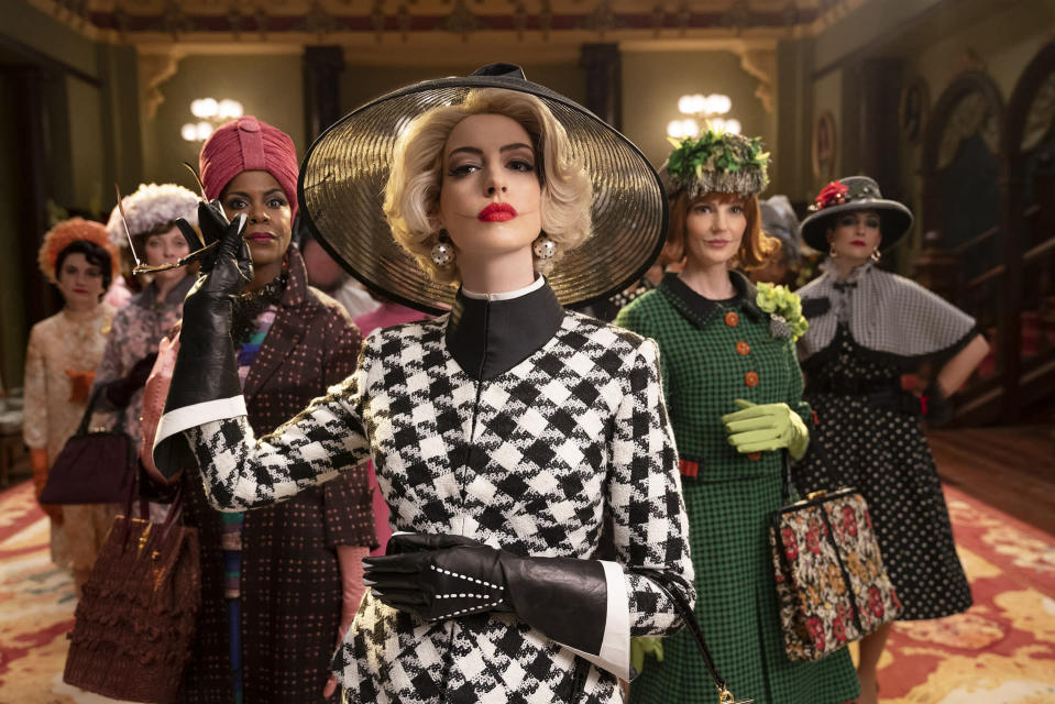 """This image released by Warner Bros. Entertainment shows Anne Hathaway, center, in a scene from """"The Witches."""" (Warner Bros. Entertainment via AP)"""