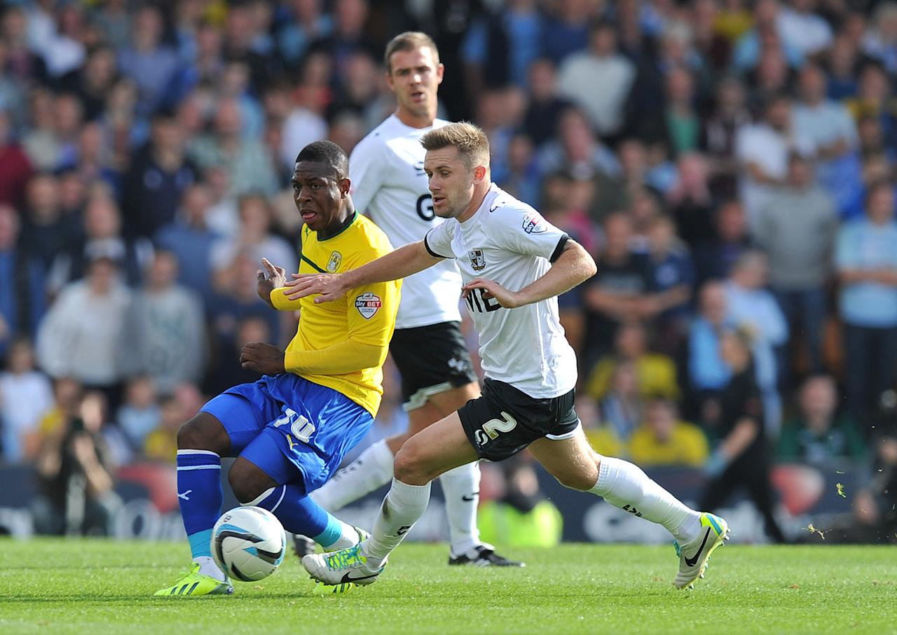 Coventry City's Franck Moussa (left) battles with Port Vale's Adam Yates (right) during the Sky Bet League One match at Vale Park, Stoke.