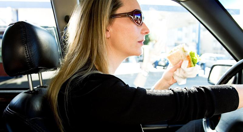 Eating in the car is not technically illegal under UK law. [Photo: Getty]