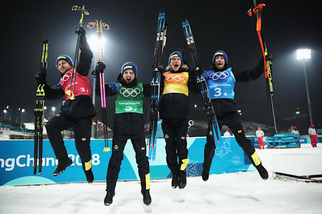 <p>(L-R) Gold medalists Peppe Femling, Jesper Nelin, Sebastian Samuelsson, and Fredrik Lindstroem of Sweden celebrate during the victory ceremony for the Men's 4×7.5km Biathlon Relay on day 14 of the PyeongChang 2018 Winter Olympic Games on February 23, 2018 in South Korea.<br> (Photo by Clive Mason/Getty Images) </p>
