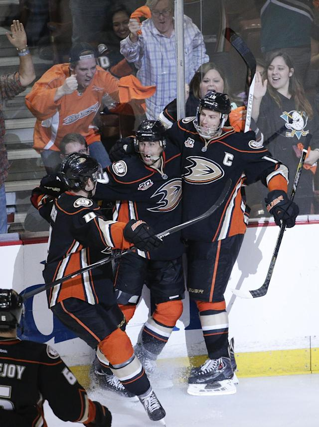 Anaheim Ducks' Andrew Cogliano, center, celebrates his goal with Ryan Getzlaf, right, and Cam Fowler during the third period in Game 2 of the first-round NHL hockey Stanley Cup playoff series against the Dallas Stars on Friday, April 18, 2014, in Anaheim, Calif. The Ducks won 3-2. (AP Photo/Jae C. Hong)