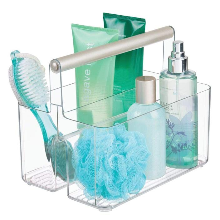 "<h3><a href=""https://www.amazon.com/mDesign-Plastic-Portable-Organizer-Bathroom/dp/B07QN1HFVG"" rel=""nofollow noopener"" target=""_blank"" data-ylk=""slk:mDesign Plastic Portable Storage Organizer Utility Caddy Tote"" class=""link rapid-noclick-resp""><strong>mDesign</strong> Plastic Portable Storage Organizer Utility Caddy Tote</a></h3> <p>A crystal-clear caddy with a steel handle is a sleek, stylish way to keep loofahs, brushes, and products readily accessible.</p> <br> <br> <strong>mDesign</strong> Plastic Portable Storage Organizer Utility Caddy Tote, $15.99, available at <a href=""https://www.amazon.com/mDesign-Plastic-Portable-Organizer-Bathroom/dp/B07QN1HFVG"" rel=""nofollow noopener"" target=""_blank"" data-ylk=""slk:Amazon"" class=""link rapid-noclick-resp"">Amazon</a>"