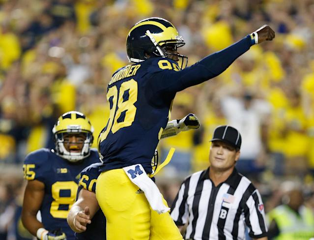 ANN ARBOR, MI - SEPTEMBER 07: Devin Gardner #98 of the Michigan Wolverines celebrates a second quarter touchdown while playing the Notre Dame Fighting Irish at Michigan Stadium on September 7, 2013 in Ann Arbor, Michigan. (Photo by Gregory Shamus/Getty Images)