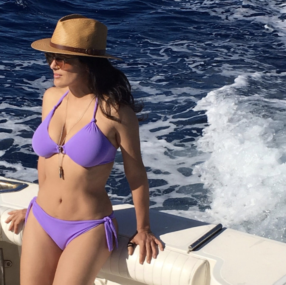 <p>Salma Hayek, 51, relaxes at sea wearing a lavender bikini, sunnies, and a hat. (Photo: Instagram/Salma Hayek) </p>