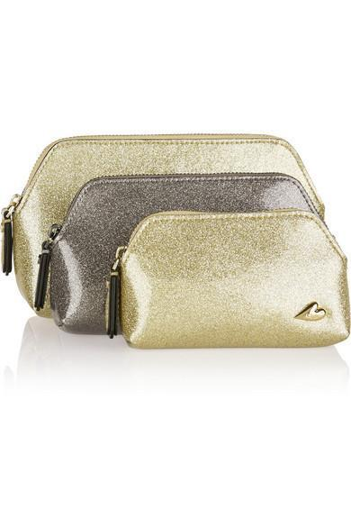 """<p>Use as makeup bags of varying sizes, and take the largest one out on the town with you. <b><a href=""""http://www.net-a-porter.com/us/en/product/644117/Diane_von_Furstenberg/love-set-of-three-glittered-pvc-pouches"""" rel=""""nofollow noopener"""" target=""""_blank"""" data-ylk=""""slk:Diane von Furstenberg Love Set of Glittered PVC Pouches"""" class=""""link rapid-noclick-resp"""">Diane von Furstenberg Love Set of Glittered PVC Pouches</a> ($120)</b></p>"""