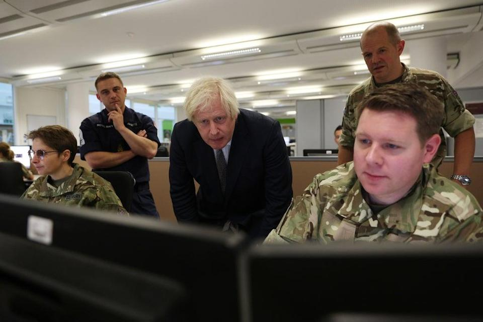 Prime Minister Boris Johnson observes the operations room for the Afghan Relocation and Assistance Policy during a visit to Northwood Headquarters, the British Armed Forces Permanent Joint Headquarters, in Eastbury, north-west London, where he met with personnel working on the UK operation in Afghanistan ((Adrian Dennis/PA))