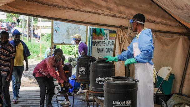 FILE - In this Friday, June 14, 2019 file photo, people coming from Congo wash their hands with chlorinated water to prevent the spread of Ebola infection, at the Mpondwe border crossing with Congo. Ugandan health authorities on Thursday, Aug. 29, 20 (The Associated Press)
