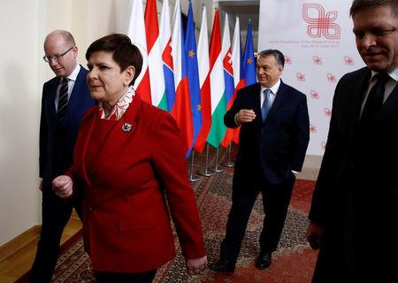 Visegrad Group (V4) member nations' Prime Ministers, Bohuslav Sobotka of the Czech Republic, Poland's Beata Szydlo, Hungary's Viktor Orban and Slovakia's Robert Fico walk after posing for a family photo during a summit in Warsaw, Poland March 2, 2017.  REUTERS/Kacper Pempel