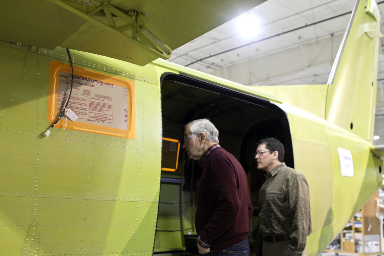 Republican presidential candidate Rep. Ron Paul, R-Texas, tours the manufacturing facility at Quest Aircraft Company with employee Paul Branham, Monday, March 5, 2012, in Sandpoint, Idaho. (AP Photo/Matt Mills McKnight)