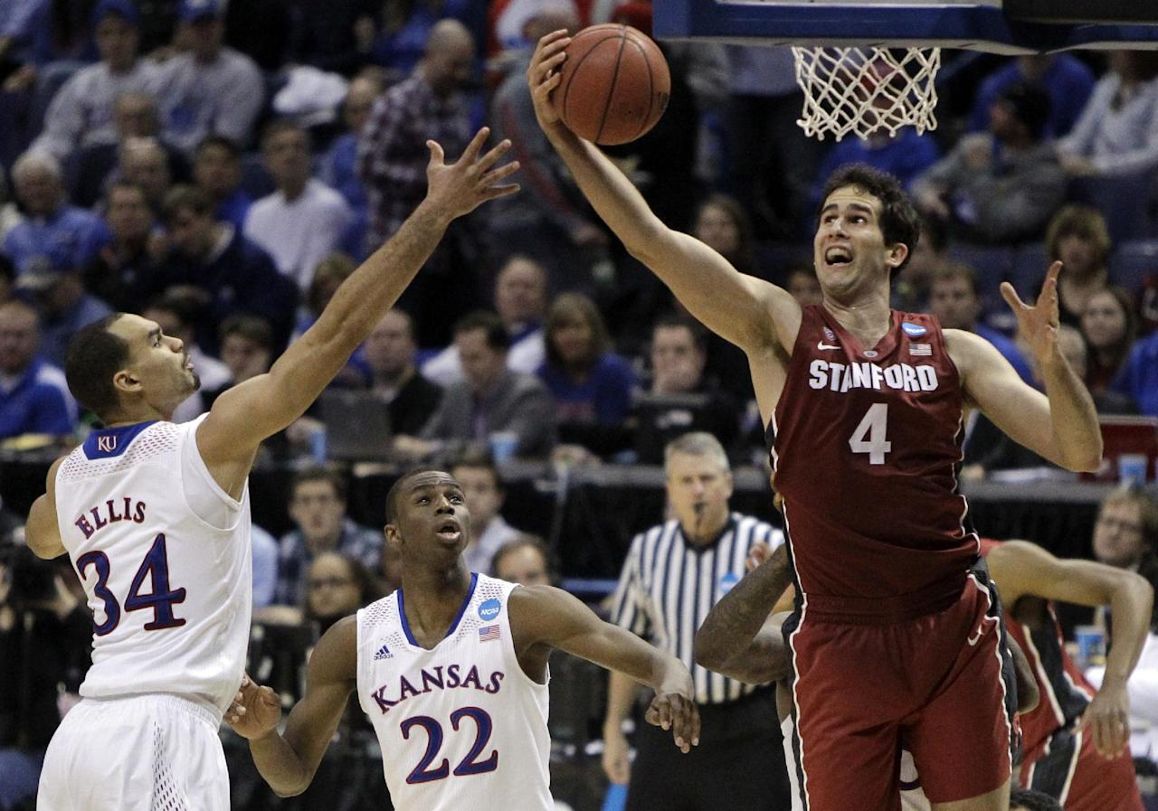 Stanford's Stefan Nastic, right, heads to the basket as Kansas' Perry Ellis, left, and Andrew Wiggins watch during the second half of a third-round game of the NCAA college basketball tournament Sunday, March 23, 2014, in St. Louis. Stanford won 60-57. (AP Photo/Jeff Roberson)