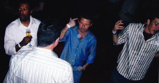 Nevin Shapiro said this photo was taken in the booster's VIP section of a nightclub in October 2008. From left to right: former prep basketball coach and current St. John's basketball staffer Moe Hicks, then-Miami assistant basketball coach Jorge Fernandez (with back to camera), Shapiro and Miami football player Robert Marve.
