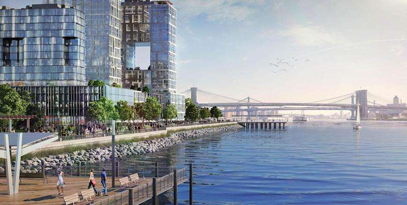 "This undated artist rendering provided by the NYC Mayor's Office shows the proposed ""Seaport City"" neighborhood to be built just south of the Brooklyn Bridge that could act as a buffer against flooding in lower Manhattan. It was part of a sweeping blueprint unveiled by Mayor Michael Bloomberg for protecting New York from rising seas, storms and other extreme weather and climate threats. (AP Photo/NYC Mayor's Office)"