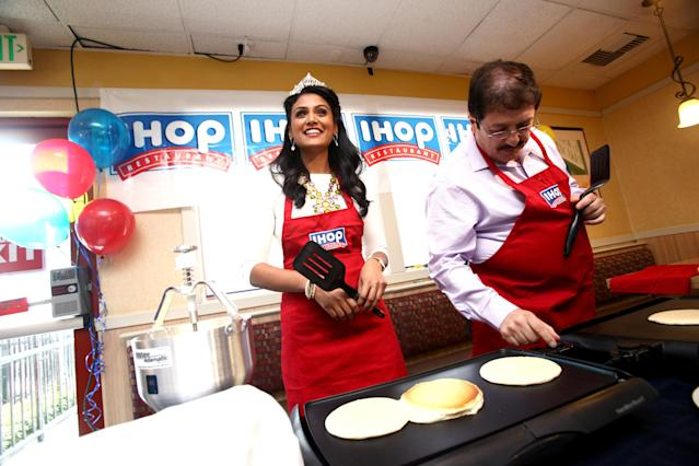 Miss America Nina Davuluri (L) and IHOP storeowner Sam Soleimani support IHOP's National Pancake Day fundraiser in L.A. held at IHOP on March 4, 2014 in Hollywood, California. (Photo by Tommaso Boddi/WireImage)